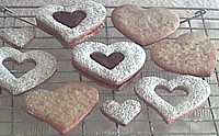 Filled and unfilled linzer heart cookies
