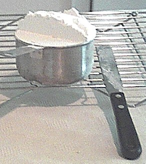 scaling flour to bake cookies
