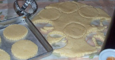 Cutting out homemade cookies for baking